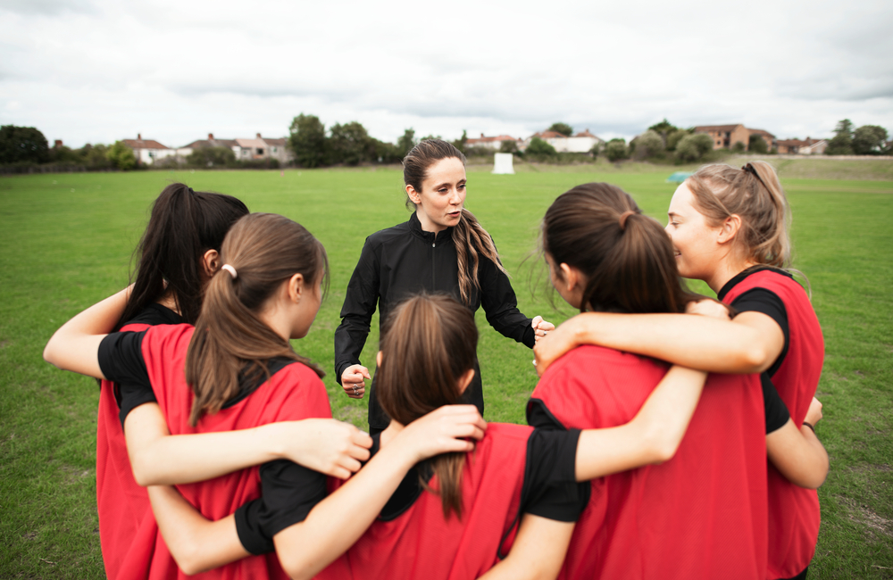 A skilled coach teaches her young students the value of teamwork. Earning a physical education certificate from Fresno Pacific University offers valuable professional development opportunities.